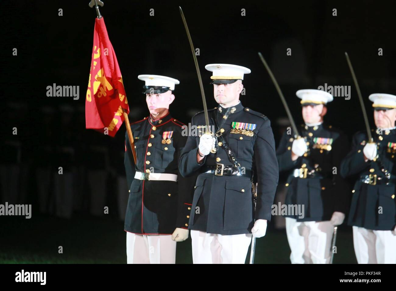 Captain Billy Grissom, company commander, Bravo Company, Marine Barracks Washington D.C., executes sword manual during a Friday Evening Parade at the Barracks, Aug. 03, 2018. The guests of honor for the parade were Ms. Ryan Manion, president, Travis Mannion Foundation, and U.S. Marine Corps Col. Tom Manion, retired, chairman emeritus, Travis Manion Foundation. The hosting official was Lt. Gen. Michael G. Dana, director, Marine Corps Staff. - Stock Image