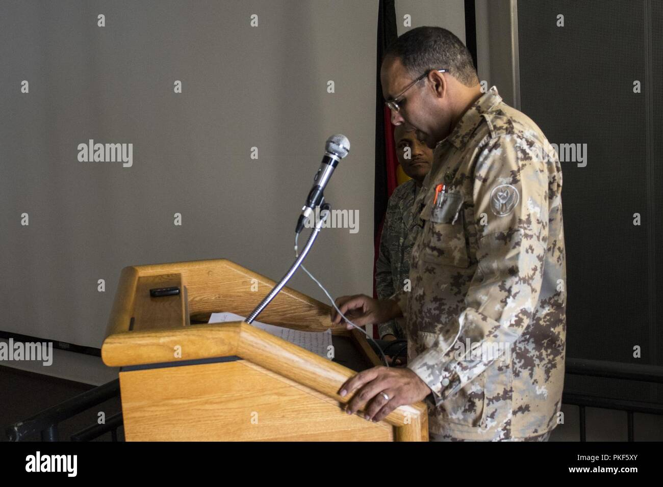 Mauritania Lt. Col. Ahmend Salem Hamza, Senior Advisor Air Chief, gives a speech to the participants of African Partnership Flight, hosted by U.S. Air Forces Africa and co-hosted by Mauritania and Senegal during its opening ceremony at Ramstein Air Base, Germany, Aug. 6, 2018. The APF program is Air Forces in Africa's premier security cooperation program with African partner nations to improve professional military aviation knowledge and skills. - Stock Image
