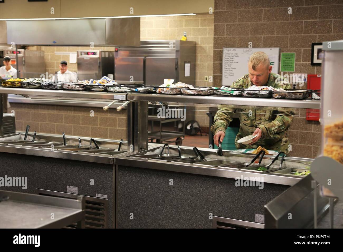 Service members enjoy a lunch meal in the dining facility in