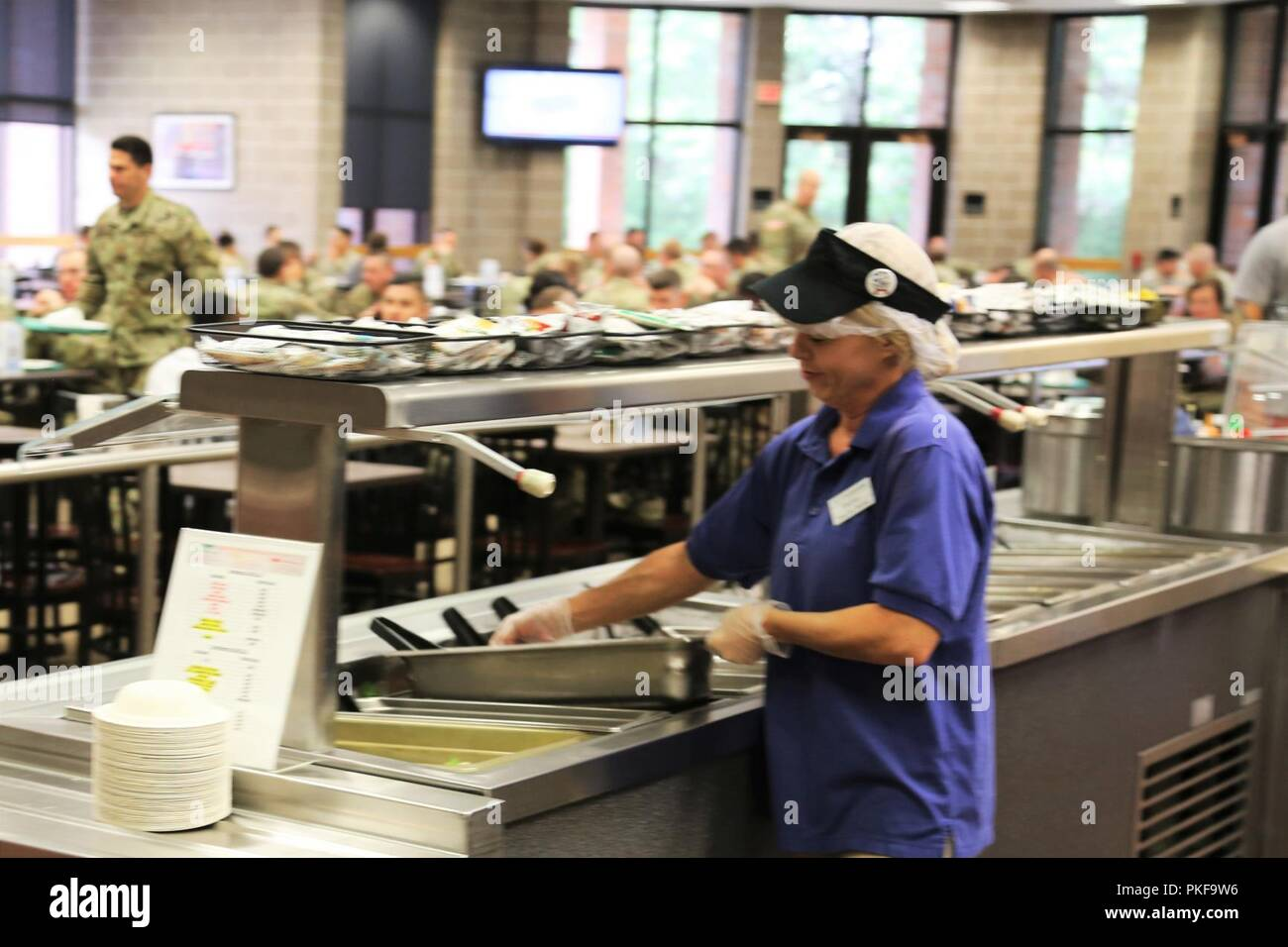 An employee with contractor DCT Inc  works in the dining facility in