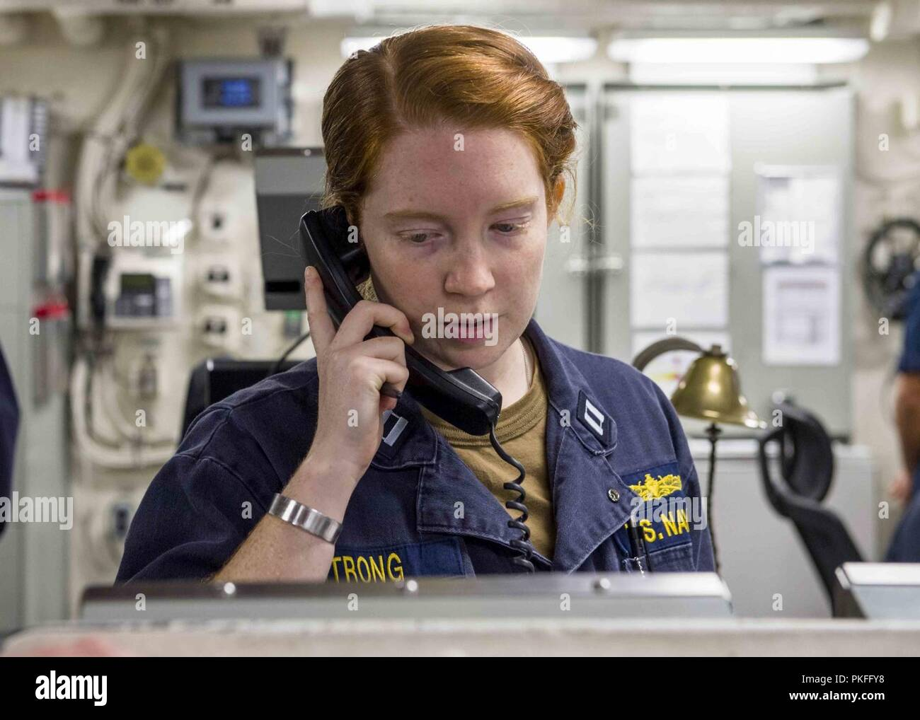 PACIFIC OCEAN (August 9, 2018) Lt. Emily Strong, from Millington, Md., stands engineering officer of the watch aboard San Antonio-class amphibious transport dock USS Anchorage (LPD 23) during a regularly scheduled deployment of the Essex Amphibious Ready Group (ARG) and 13th Marine Expeditionary Unit (MEU). The Essex ARG/MEU team is a strong and flexible force equipped and scalable to respond to any crisis ranging from humanitarian assistance and disaster relief to contingency operations. - Stock Image