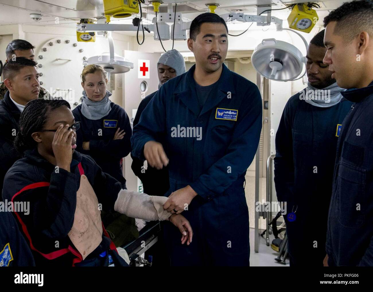 PACIFIC OCEAN (July 28, 2018) Hospital Corpsman 2nd Class Andrew Kim, from Fullerton, Calif., conducts emergency medical training in the medical ward of San Antonio-class amphibious transport dock USS Anchorage (LPD 23) during a regularly scheduled deployment of Essex Amphibious Ready Group (ARG) and 13th Marine Expeditionary Unit (MEU). The Essex ARG/MEU team is a strong and flexible force equipped and scalable to respond to any crisis ranging from humanitarian assistance and disaster relief to contingency operations. - Stock Image