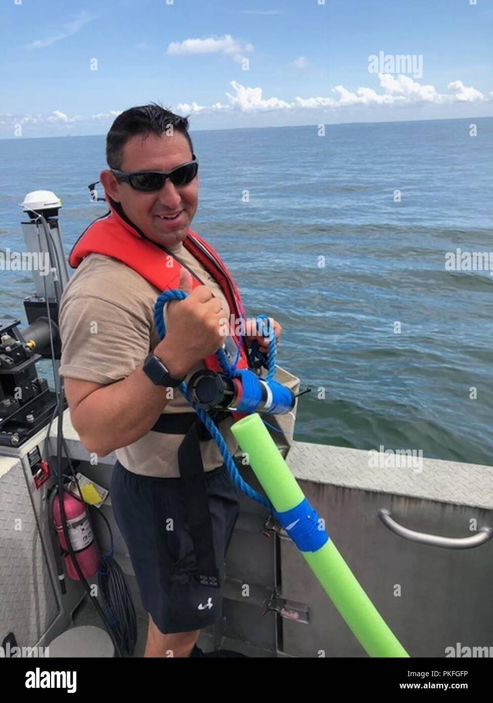 On Aug. 7, 2018, AGC Wesley Bell with Naval Oceanography Mine Warfare Center aboard NOAA's National Response Team-1 in Gulf of Mexico deploying a sonar reflector with an attached defense system sonar pinger that will be surveyed to determine ground truth. This exercise is part of the Gulf Coast portion of Naval Undersea Warfare Center's Advanced Naval Technology Exercise. - Stock Image