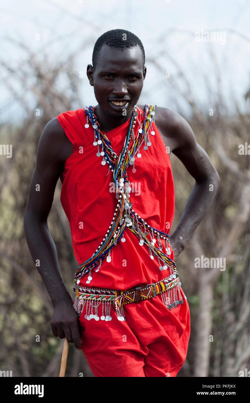 Masai Warrior in traditional clothing Masai Mara Kenya East Africa - Stock Image
