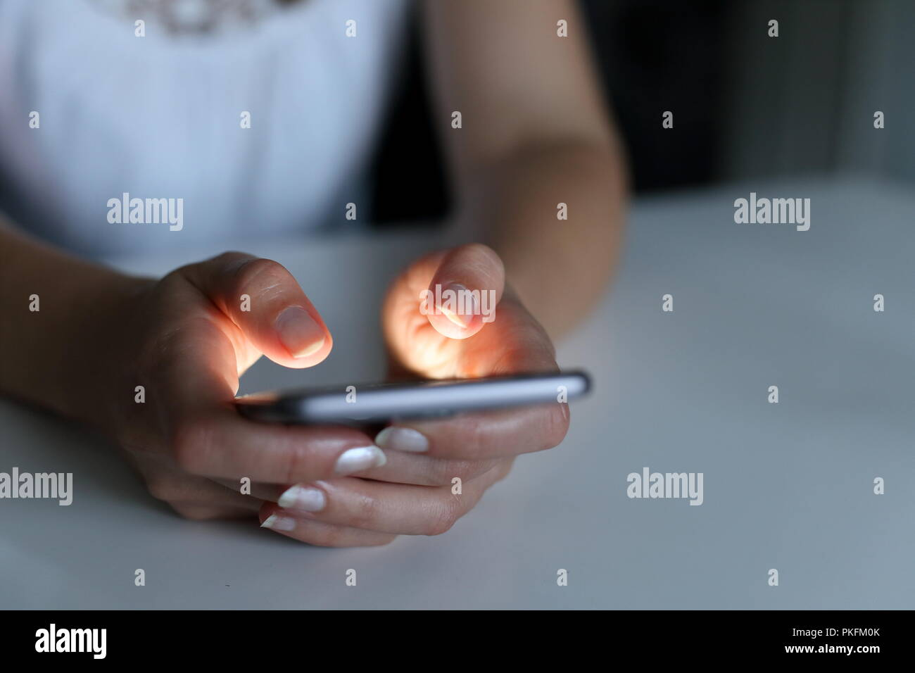 A Woman with smartphone at night - Stock Image