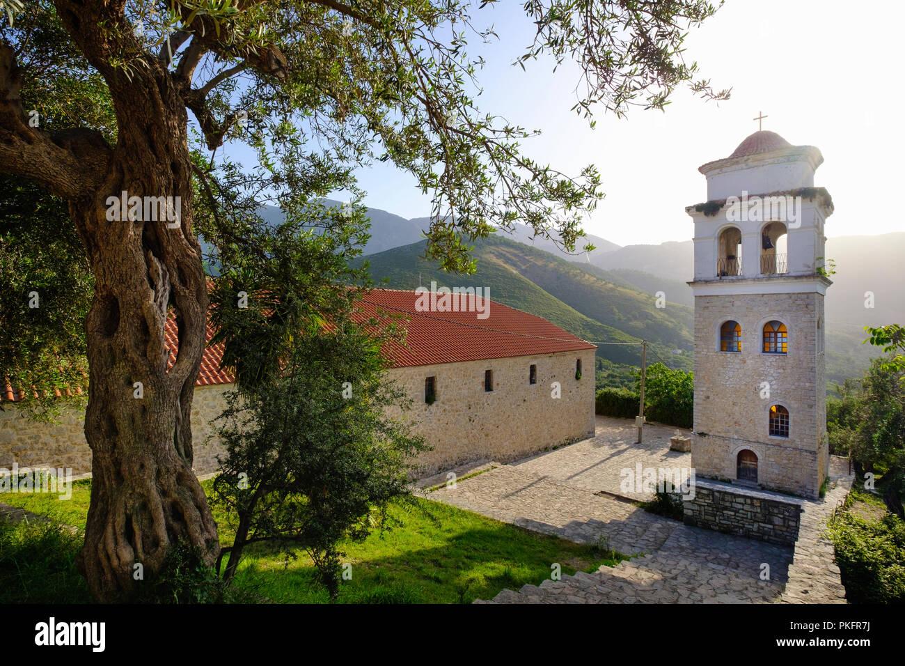 Orthodox All Saints church with belfry, ancient mountain village Himara, Himarë, Qark Vlora, Albania - Stock Image