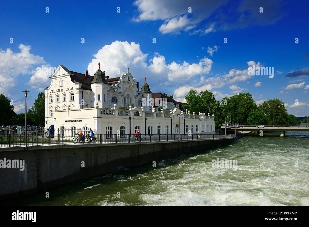 Cyclists in Landshut in front of the locksmith Ussar an der Isar, East Bavaria, Lower Bavaria, Bavaria, Germany - Stock Image