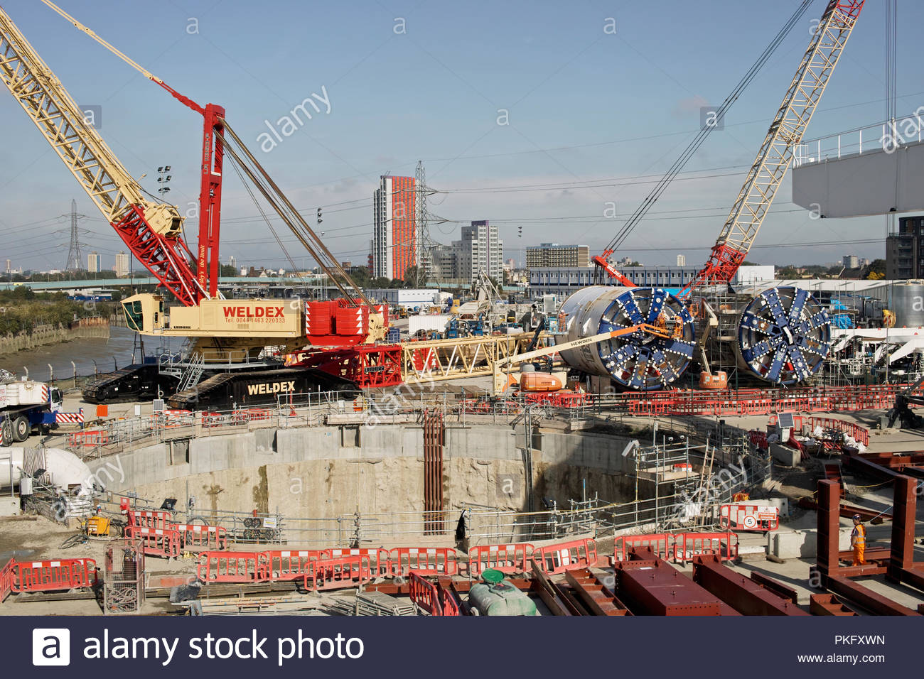 Workers prepare the tunnel boring machines (TBM) at the Limmo Peninsular site: Canning Town, London. - Stock Image
