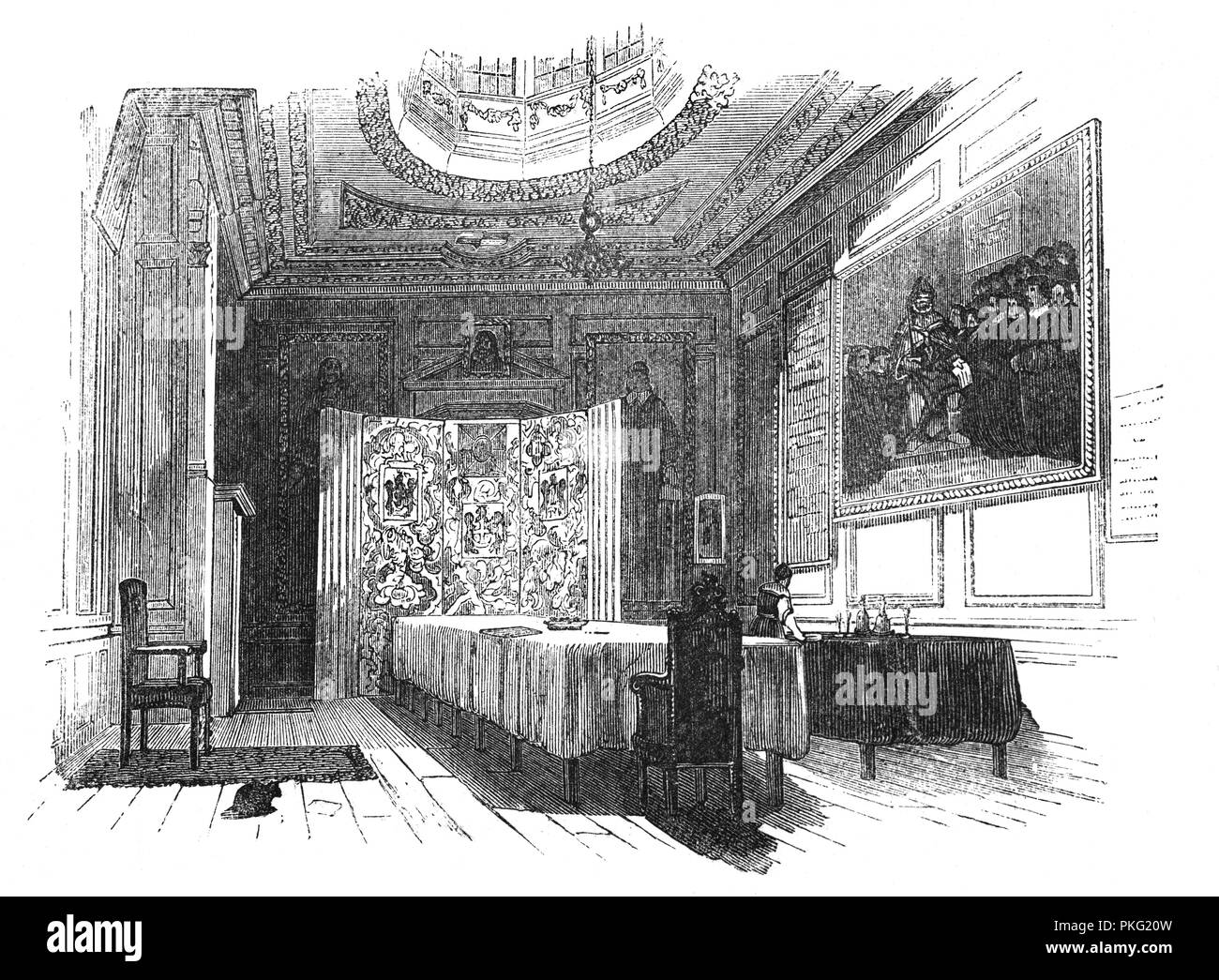 The courtroom of the Worshipful Company of Barbers, one of the Livery Companies of the City of London. The Fellowship of Surgeons merged with the Barbers' Company in 1540, forming the Company of Barbers and Surgeons.  The Act specified that no surgeon could cut hair or shave another, and that no barber could practice surgery; the only common activity was to be the extraction of teeth. The barber pole, featuring red and white spiralling stripes, indicated the two crafts (surgery in red and barbering in white).  Following the rising professionalism of the (surgeons) trade they broke away in 1745 Stock Photo
