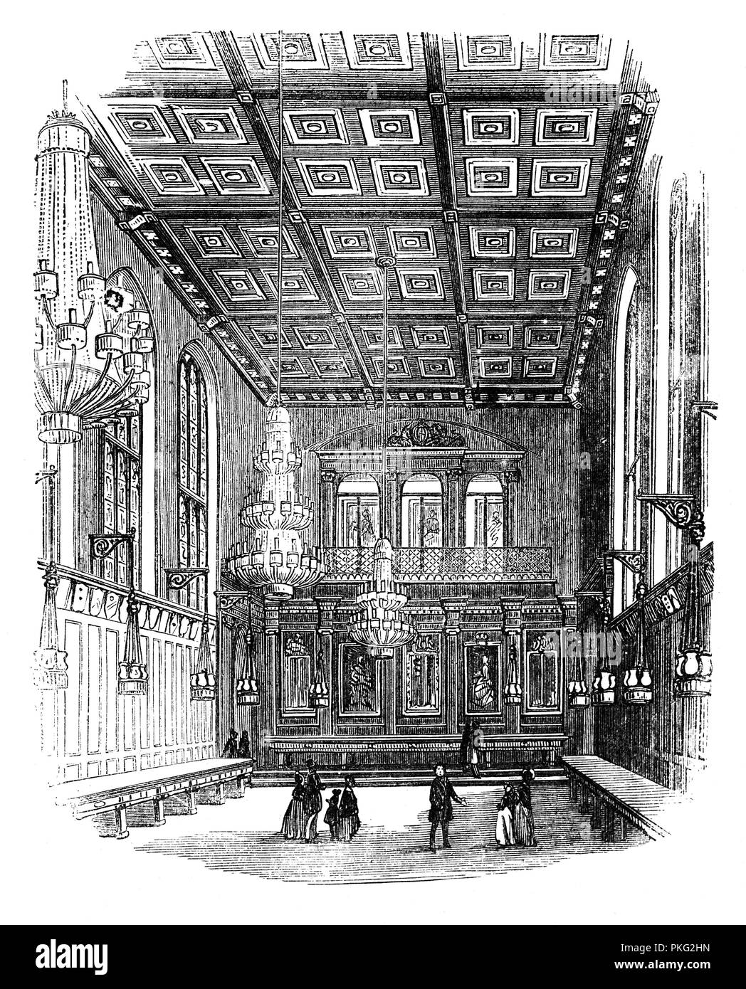 The Interior of Merchant Taylors' Hall, London is the seat of the Worshipful Company of Merchant Taylors, one of the Twelve Great Livery Companies of the City of London surviving from Mediaeval times. The first hall was built between Threadneedle Street and Cornhill at some date between the years 1347 and 1392. At the time of the Great Fire, only the walls and foundations survived, but the building was restored. - Stock Image