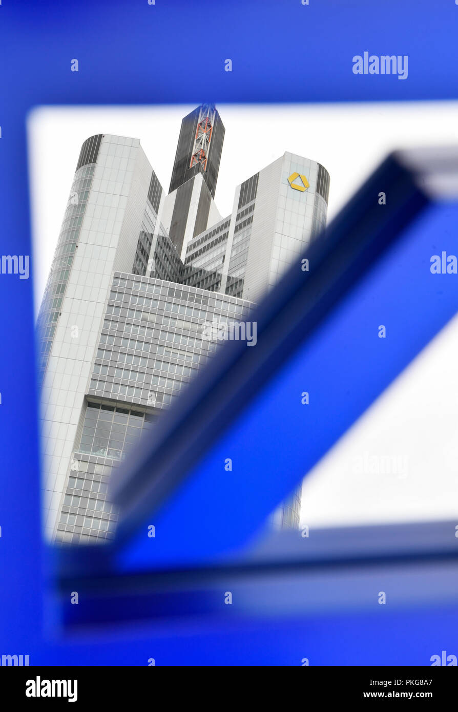 13 September 2018, Hessen, Frankfurt/Main: ILLUSTRATION - 13 September 2018, Germany, Frankfurt/Main: The Commerzbank headquarters can be seen in a mirror with the Deutsche Bank logo. Again and again there is speculation about a merger of the two financial institutions. Photo: Arne Dedert/dpa - Stock Image