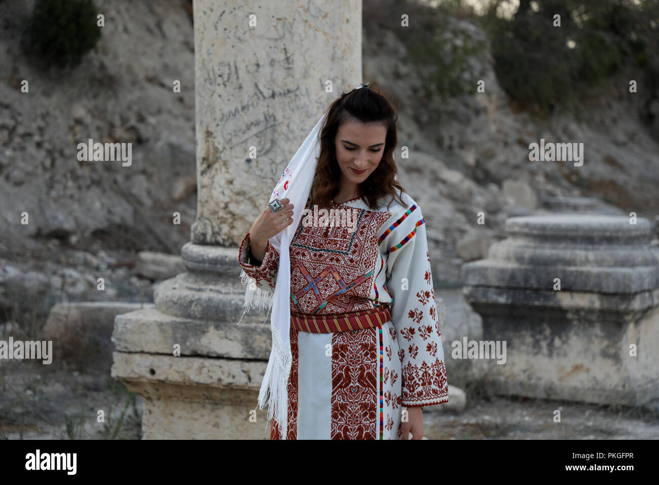 September 12, 2018 - Palestinians celebrate the ninth Sebastia festival of tourism and folklore reviving their history and heritage in the West Bank village of Sebastia, in the northwest of Nablus. Above the built up area of the Sebastia village on the eastern slope of the hill is the Sebastia archaeological site comprising remains from six successive cultures including Canaanite, Israelite, Assyrians, Chaldeans, Hellenistic, Herodian, Roman, Byzantine, Crusaders, and Ottoman history. In addition to its historical and archaeological importance Sebastia is also home to ancient olive groves ( - Stock Image