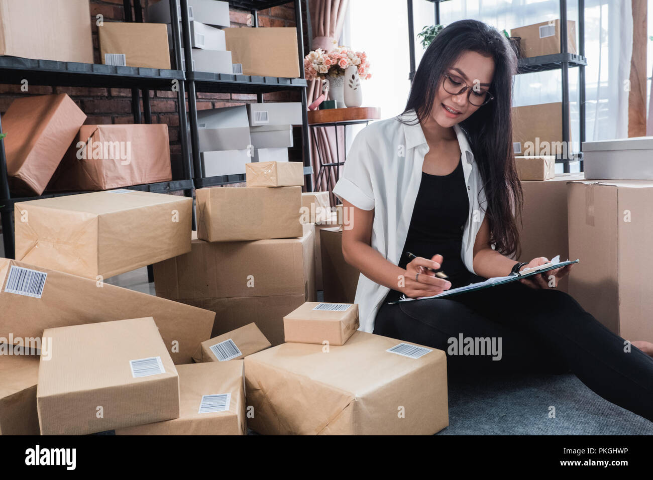working at home and check shipping packages - Stock Image
