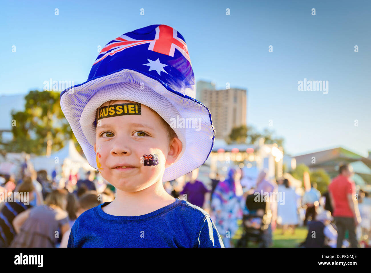 Cute Australian boy with Aussie tattoos on his face on Australia Day celebration in Adelaide - Stock Image