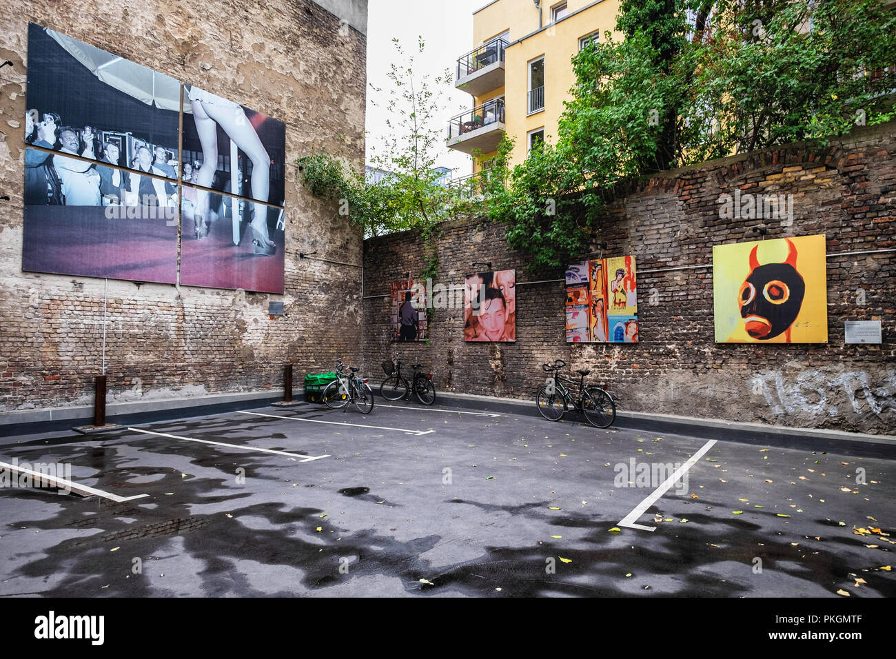 Berlin,Mitte,Torstrasse 109. Open-air gallery with exhibition of large photographic images by CAMERADOS in an inner courtyard of a building. - Stock Image