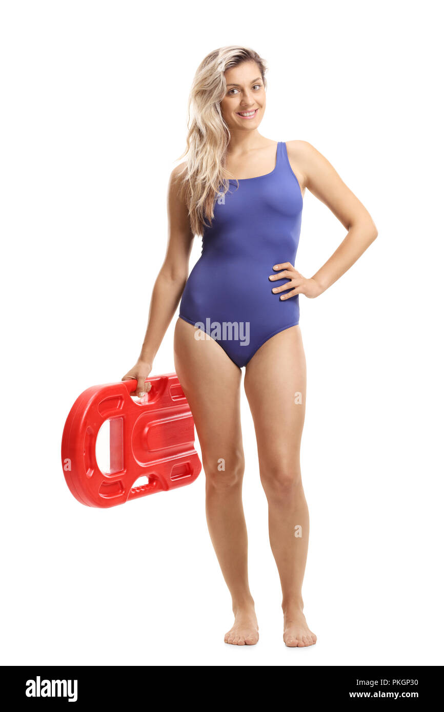 Full length portrait of a young woman in a swimming suit holding a swimming board isolated on white background - Stock Image