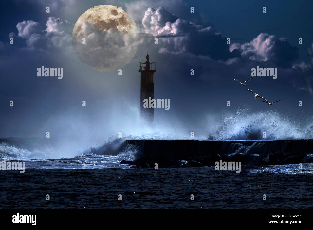 Conceptual image over an unlit beacon in a stormy full moon night - Stock Image