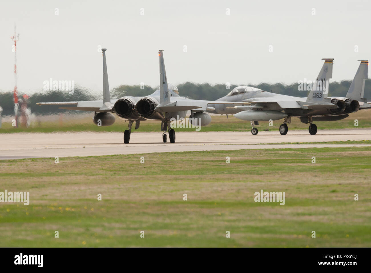 F-15 aircraft jet fighters taxying on runway at RAF Lakenheath, Suffolk, UK. Unsharpened - Stock Image