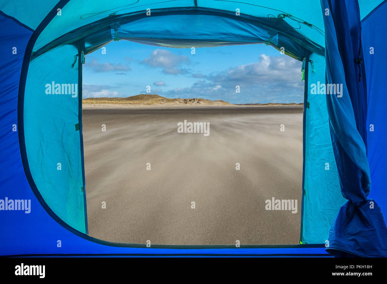 View from inside a tent onto a beach in Texel, the Netherlands. - Stock Image