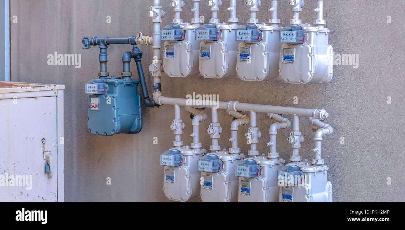 Energy meters of apartment building Park City - Stock Image