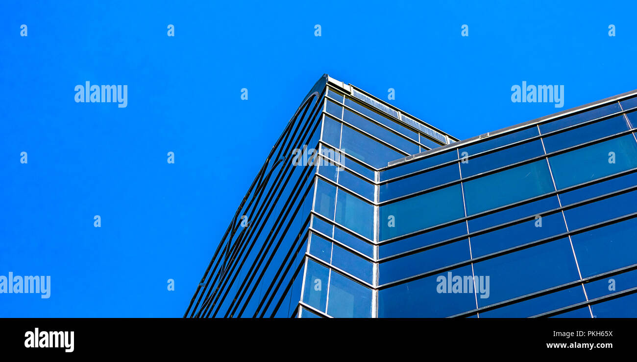 Modern building with blue glass windows - Stock Image