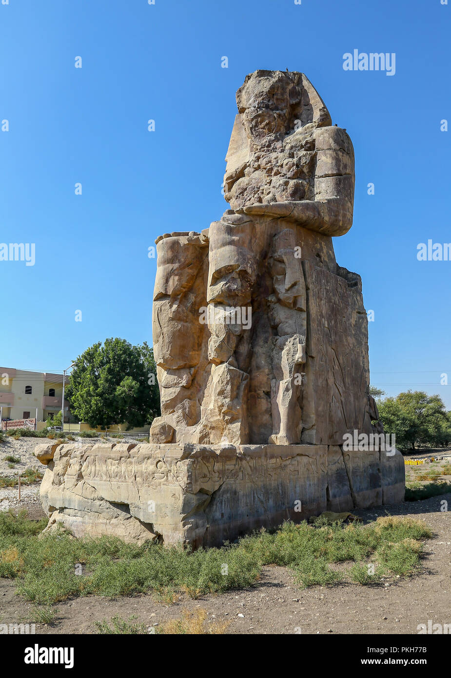 The Colossi of Memnon, two massive stone statues of the Pharaoh Amenhotep III, at the Theban Necropolis at Luxor, Egypt, Africa - Stock Image