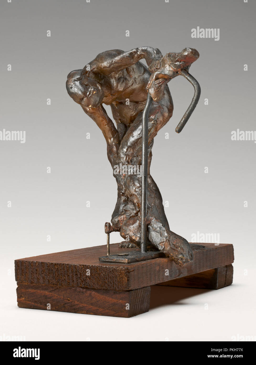 Woman Washing Her Left Leg. Dated: c. 1890s. Dimensions: overall without base: 14.7 x 11.4 x 13.5 cm (5 13/16 x 4 1/2 x 5 5/16 in.). Medium: pigmented beeswax, metal armature, on wooden base. Museum: National Gallery of Art, Washington DC. Author: EDGAR DEGAS. - Stock Image