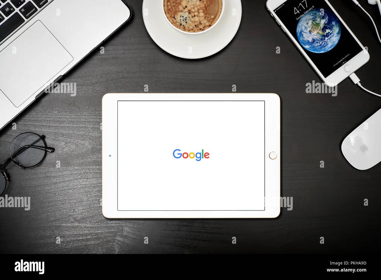 Kyiv, Ukraine - Fabruary 6, 2018: Apple iPad Gold with Google search  app on the screen on black desk, top view. Google search application is the sear - Stock Image