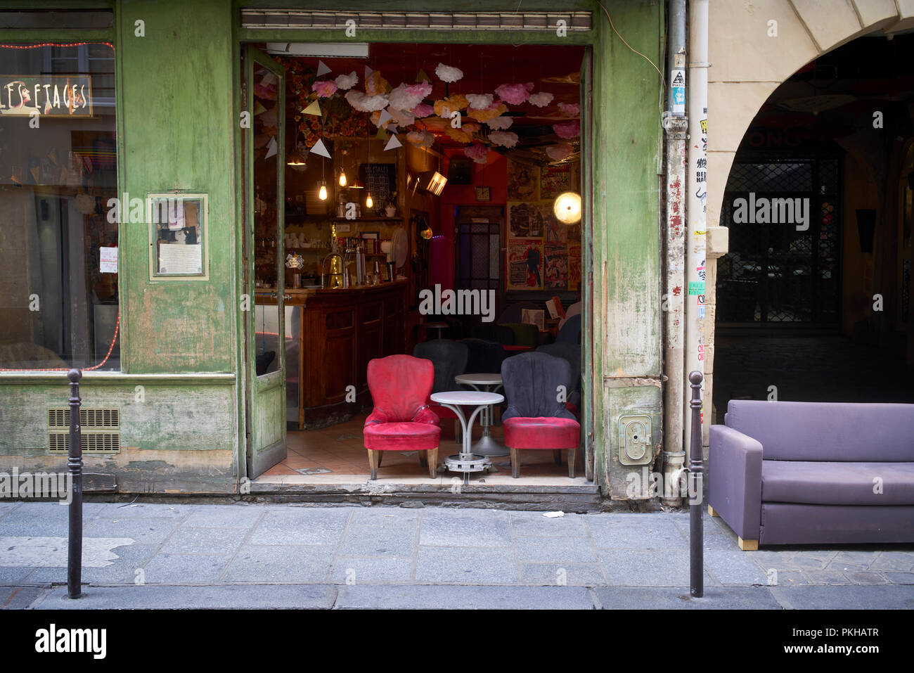 Chairs and sofa outside a bar in Le Marais area in Paris, France - Stock Image
