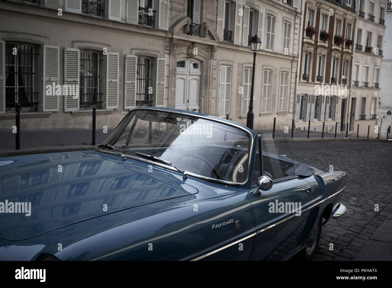 Renault old-timer parked on street in Montmartre, Paris - Stock Image