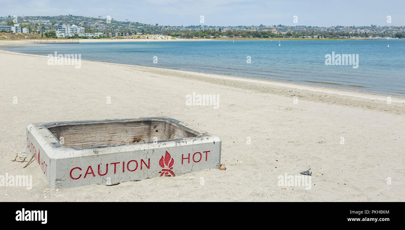 White container in the sand at San Diego beach - Stock Image