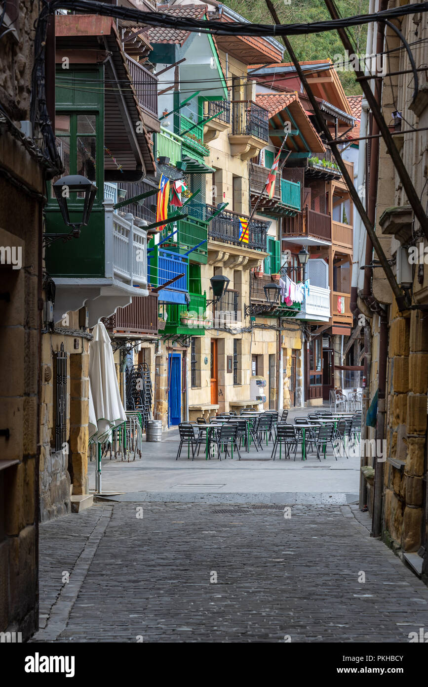 Outdoor seating and historic buildings in Pasai Donibane, Spain - Stock Image