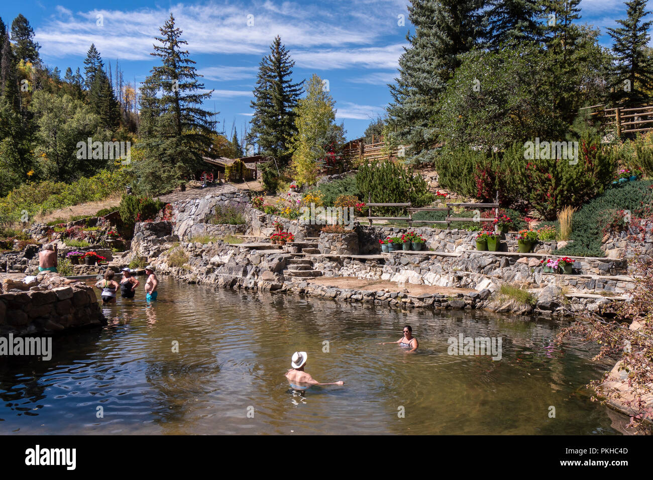 Bathers soak in the warm water, Strawberry Park Hot Springs, Steamboat Springs, Colorado. - Stock Image
