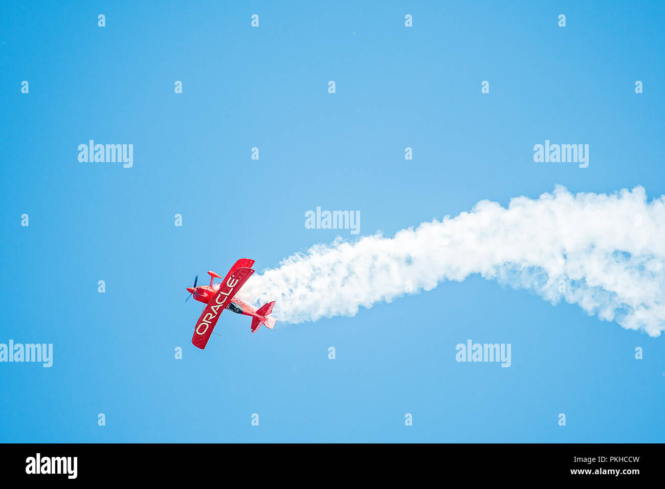 Oshkosh, WI - 28 July 2018:  A bi-plane sponsored by Oracle does stunts at an airshow - Stock Image