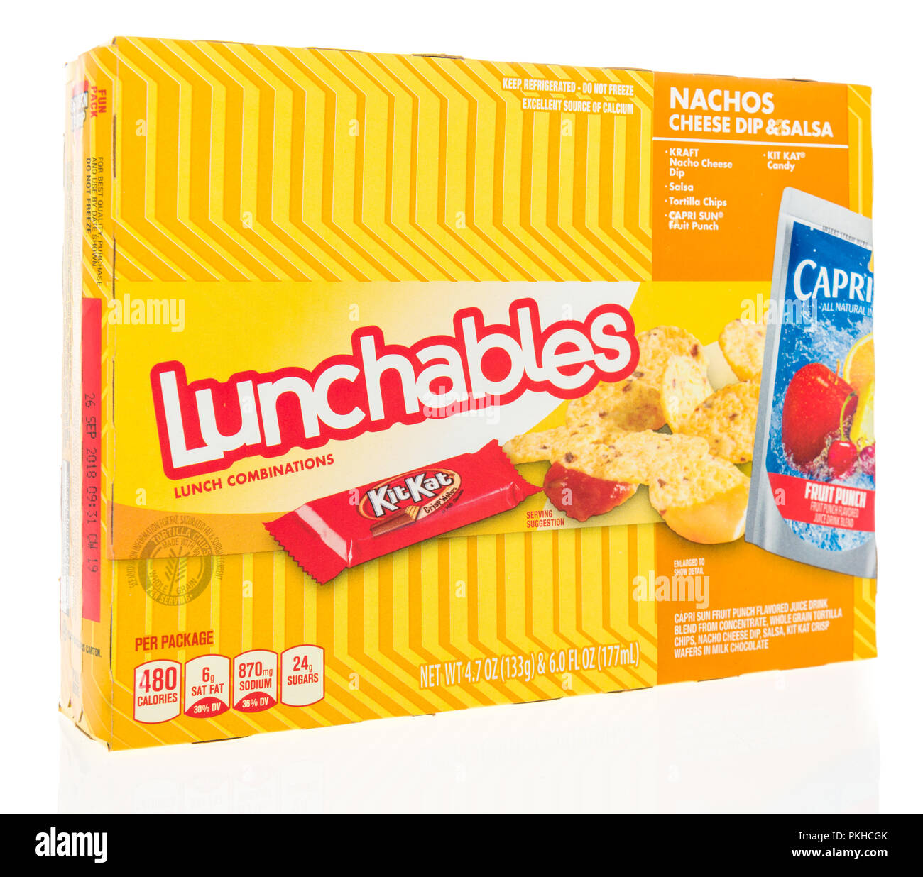 Winneconne, WI - 9 September 2018: A package of Lunchables with Kraft cheese, Capri Sun drink and a KitKat candy bar on an isolated background - Stock Image