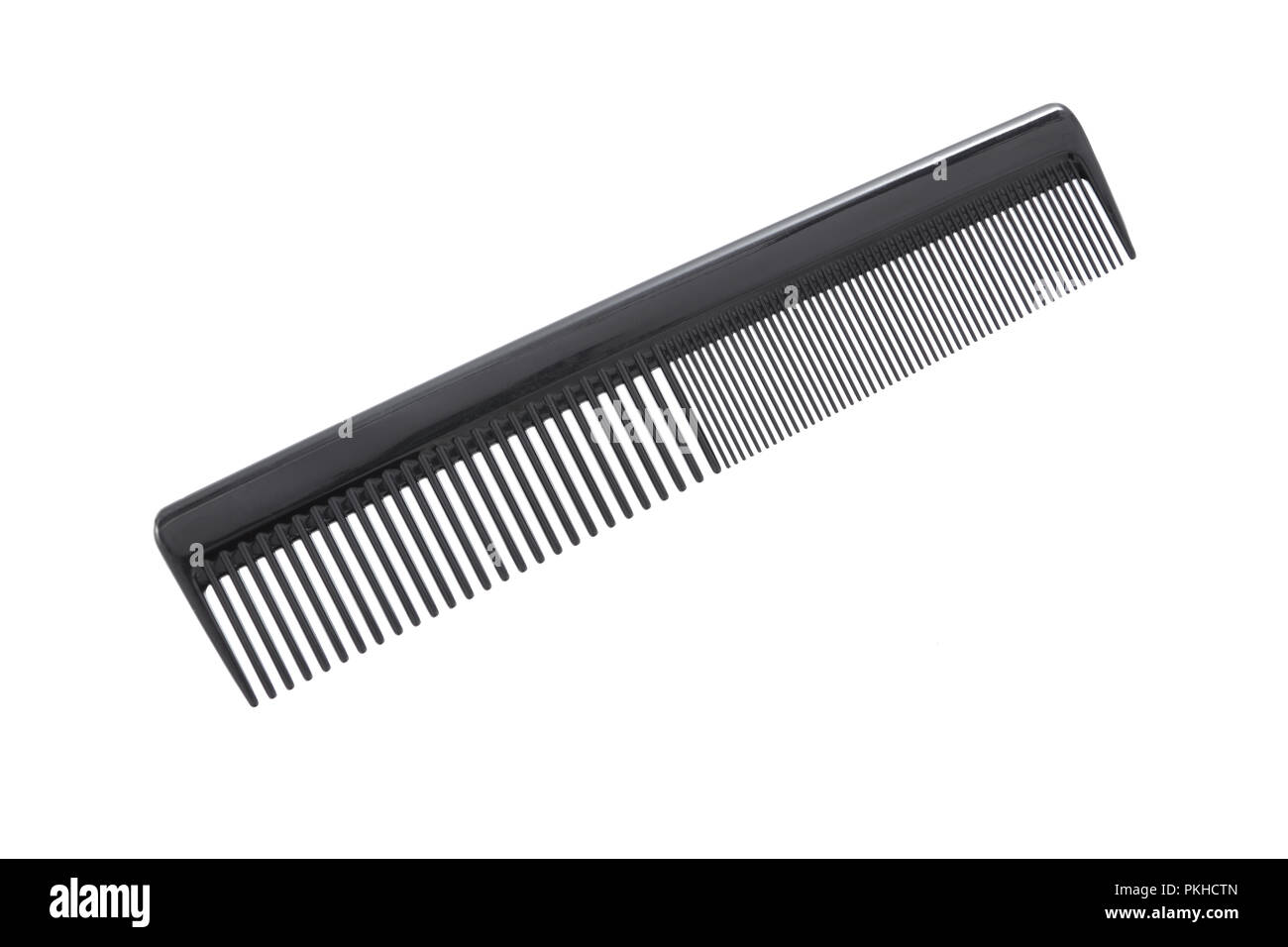 Black hair comb isolated on a white background - Stock Image