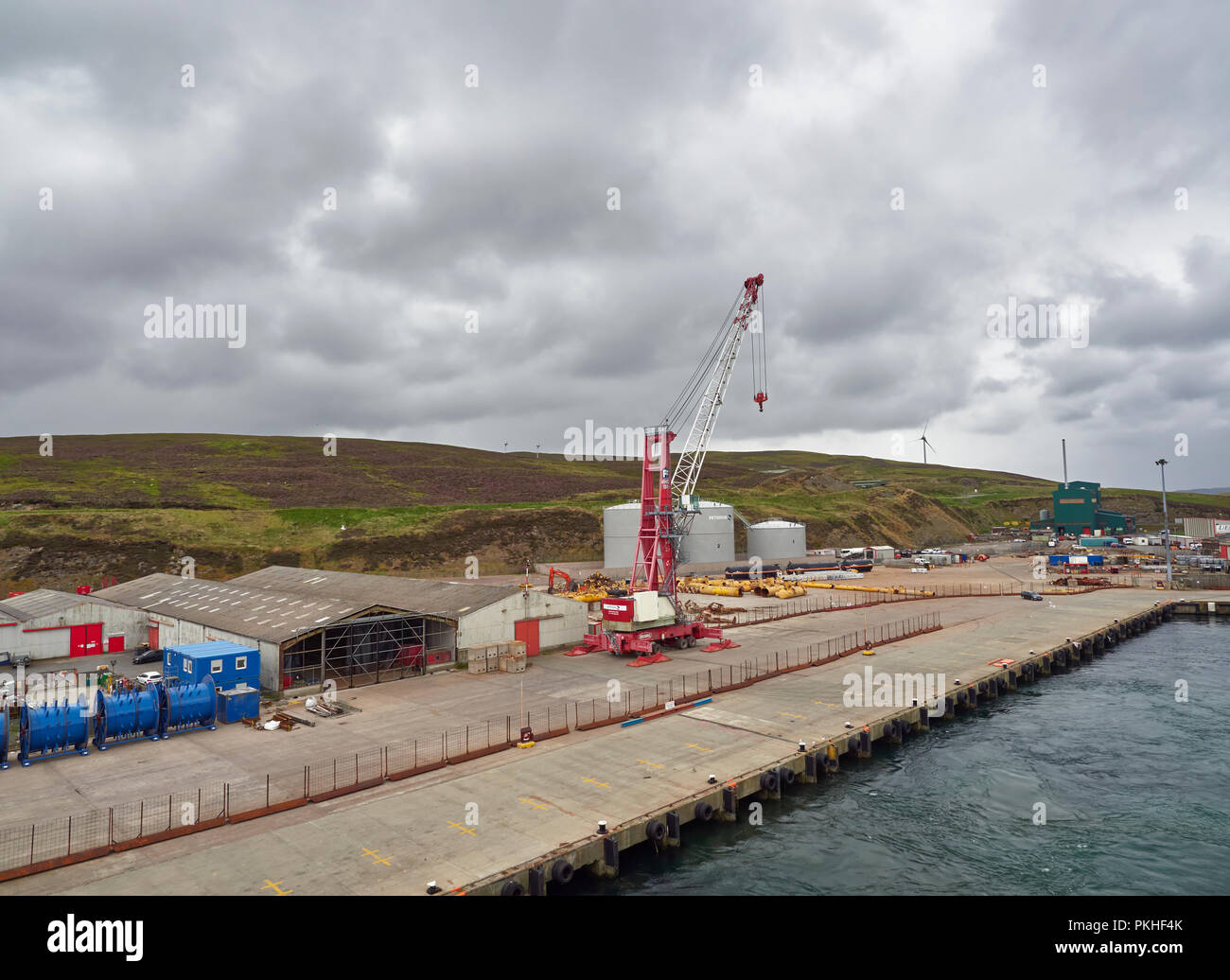 The working Peterson Quay in the town of Lerwick, with a fenced off working area with a mobile Crane.Shetland Islands, Scotland, UK - Stock Image
