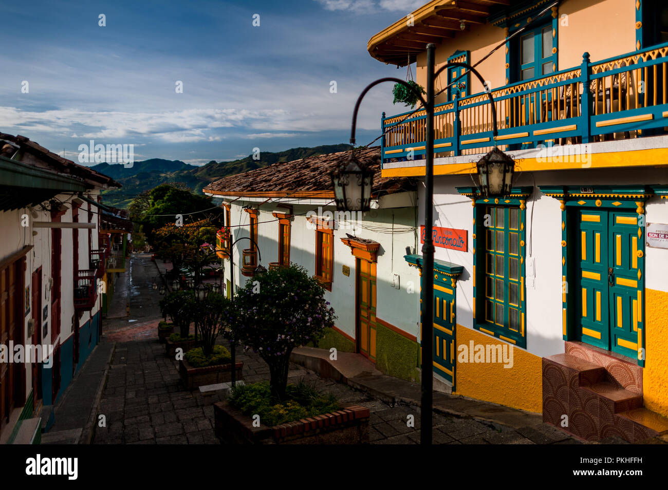 Colorfully painted wooden balconies and windows are seen at a colonial house during the sunrise in Jericó, a village in the coffee region (Zona cafete Stock Photo