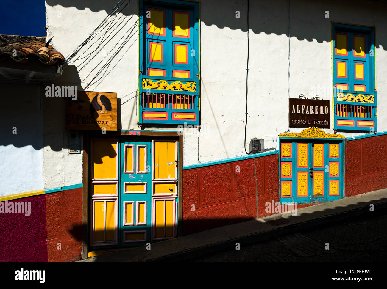 Colorfully painted wooden balconies and doors are seen at a colonial house in Jericó, a village in the coffee region (Zona cafetera) of Colombia, 24 A Stock Photo