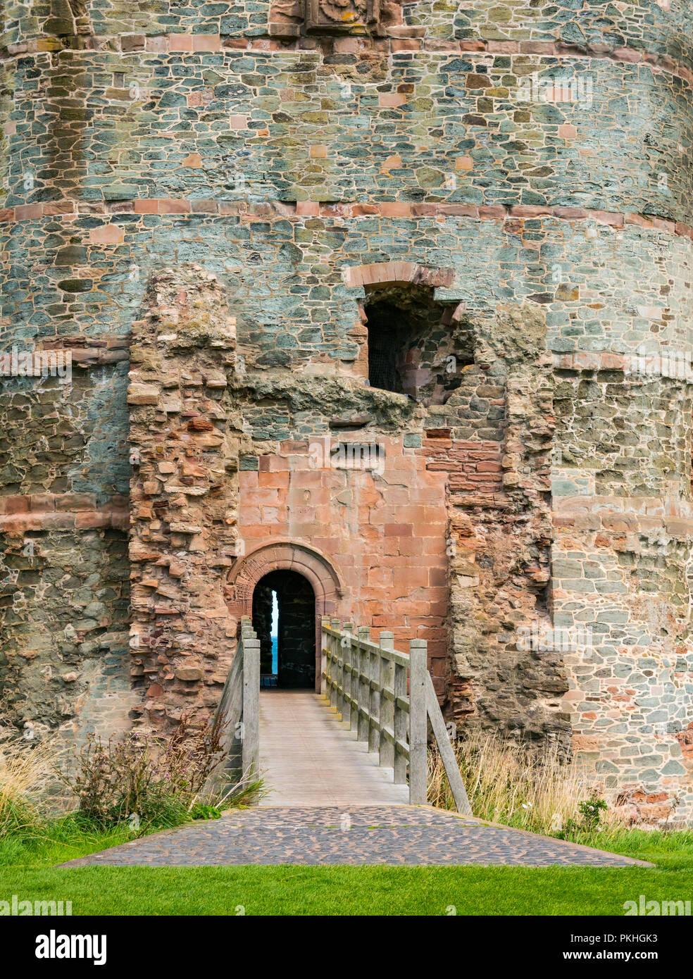Moat bridge entrance of 14th century curtain wall fortified Tantallon Castle, North Berwick, East Lothian, Scotland, UK - Stock Image