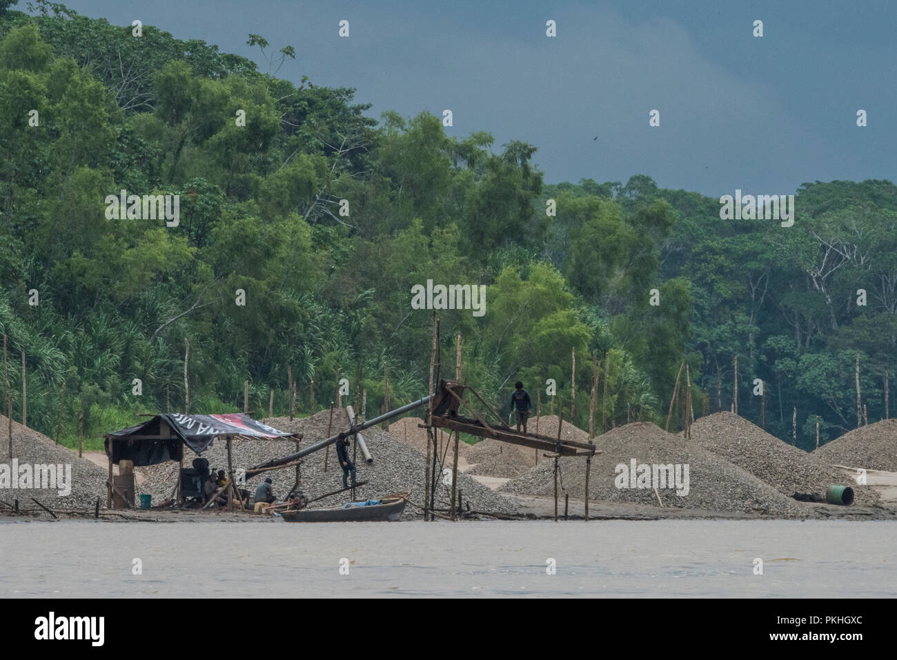 Gold mining along the Madre de Dios river in Peru.  In recent years mining has undergone a boom and become a serious environmental hazard. - Stock Image