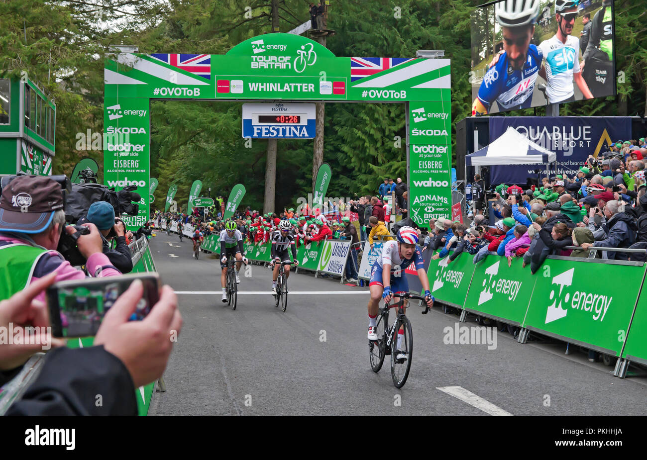 Stage 6 Tour of Britain 7 September 2018, Whinlatter Visitor Centre. Photographers lean over barriers to capture exhausted riders at the finish line. - Stock Image
