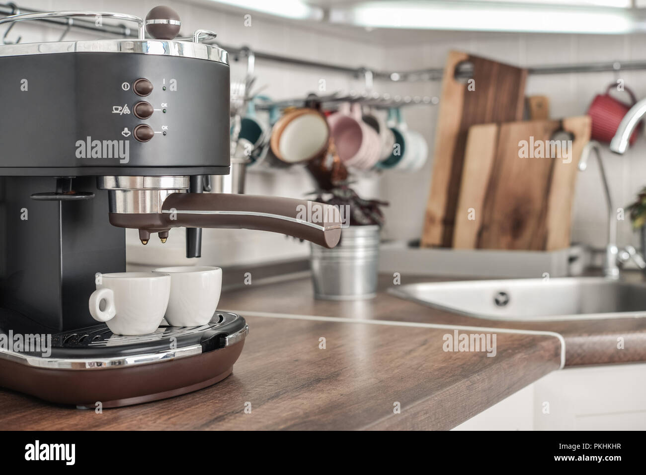 Coffeemaker With Two Cups In Interior Of Modern Kitchen Closeup
