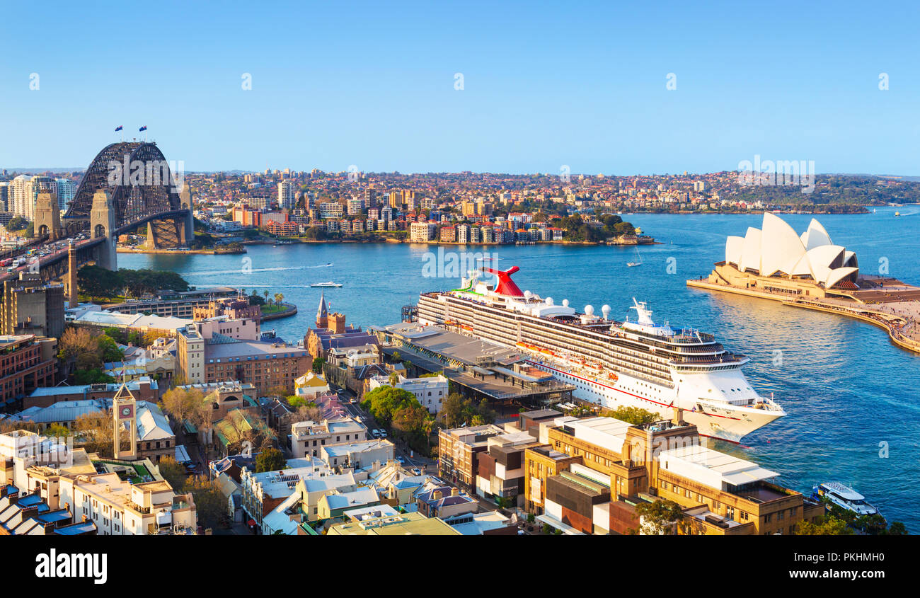 Sydney Harbour Bridge and Sydney opera House with the Carnival Spirit Cruise Ship docked at the Overseas Passenger Terminal. Australia - Stock Image