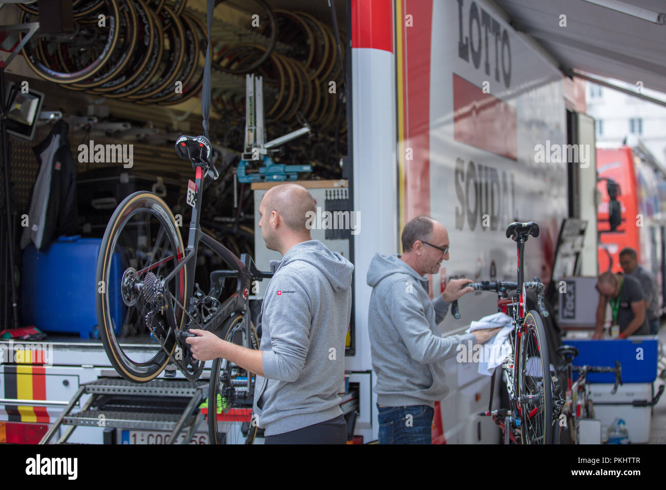 Tour of Britain 2018, London,GB. Bicycle mechanics of team Lotto Soudal, hard at work back stage preparing and fine tuning bikes before the last stage - Stock Image