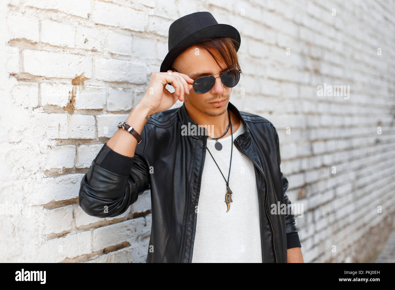 Fashionable young handsome man wearing sunglasses 45301265854