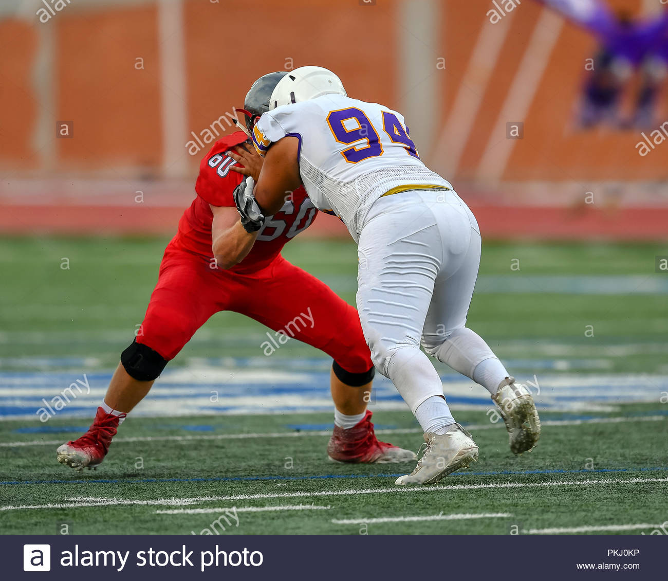 High School Football players making amazing plays during a game - Stock Image