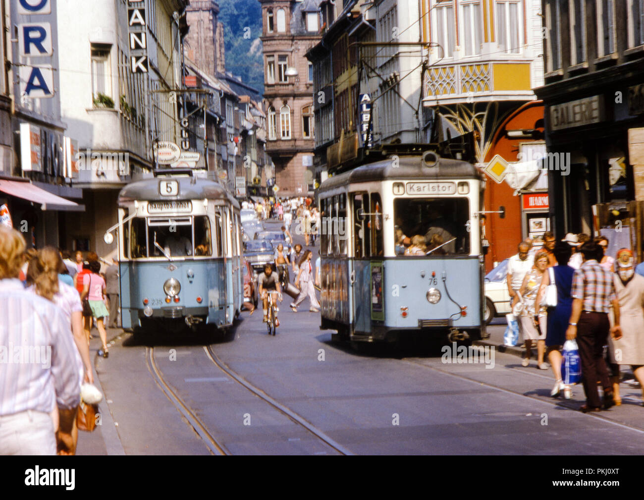Busy with shoppers and trams on Hauptstrasse, Altstadt, Heidelberg, Germany taken in August 1973. Original archive photograph. - Stock Image