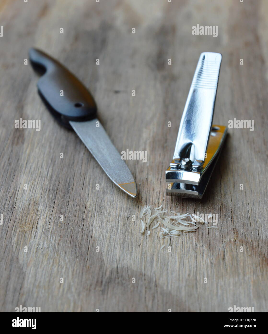 nail clipper and emery file on plank - Stock Image