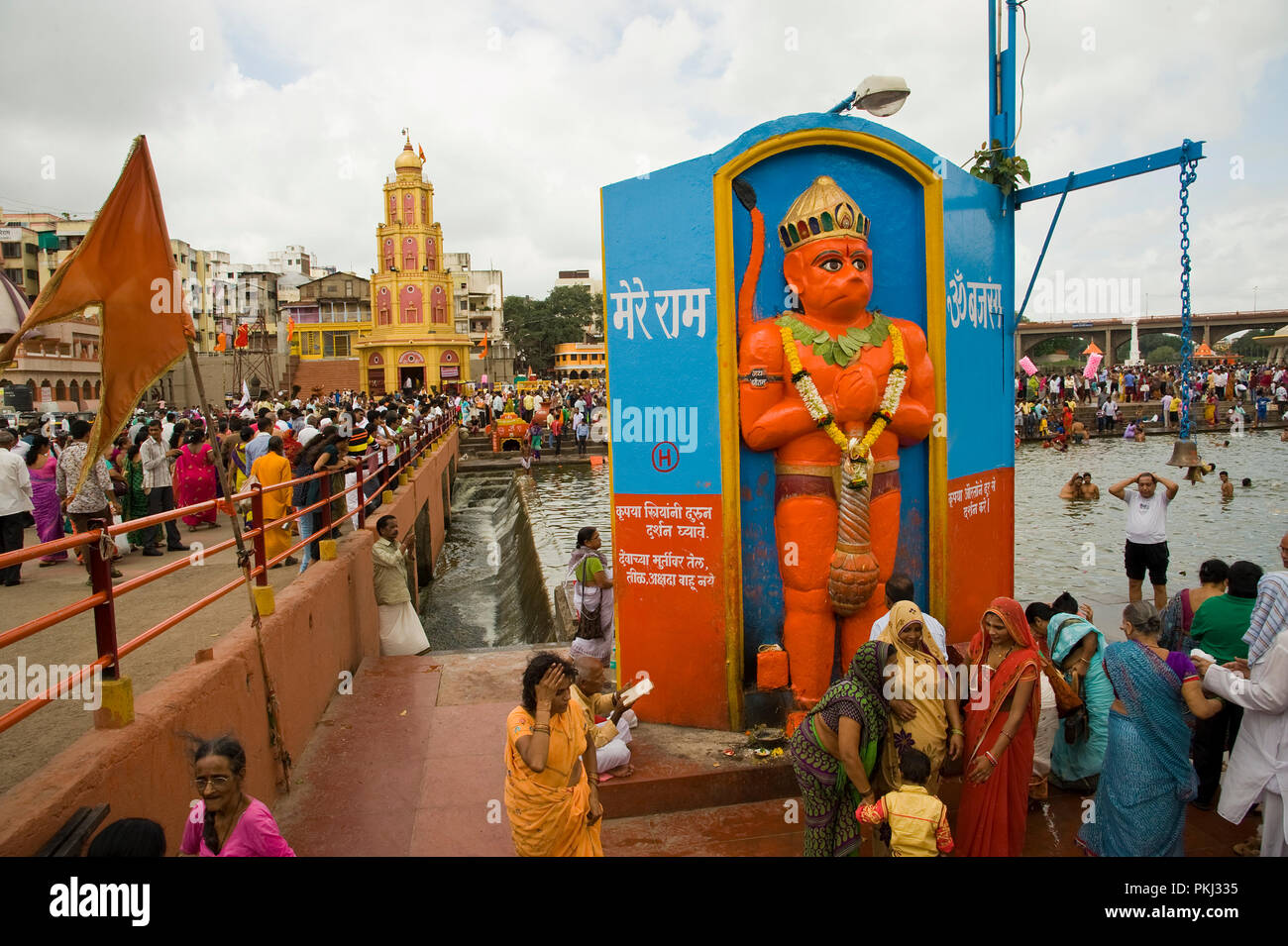 Devotees worship Lord Hanuman statue on the occasion of